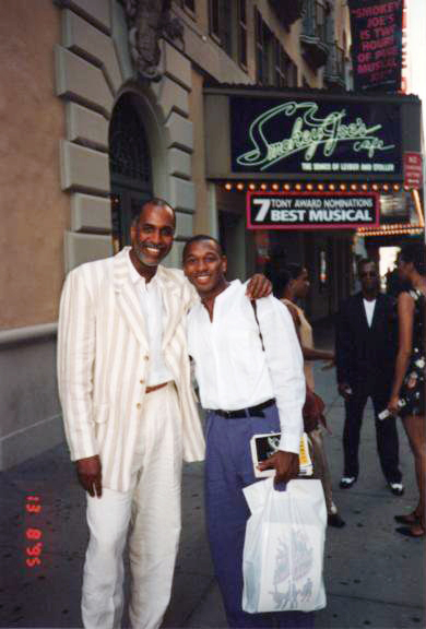 Alton Fitzgerald White and stage manager, Ken Hanson, in front of the Broadway marquis of Smokey Joe's Café